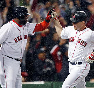 David Ortiz (2 for 3, HR, RBI) congratulates J.D. Drew, who scores on Mike Lowell's sacrifice fly in the eighth.