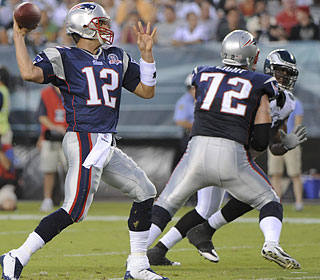 Welcome back! Tom Brady completes 10 of 15 passes for 100 yards and two touchdowns.  (US Presswire)