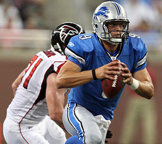 Matthew Stafford goes 7 for 14 for 114 yards, but is not helped by some drops.  (US Presswire)