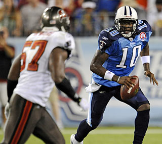 Vince Young shows off his talent against Tampa Bay, throwing for 131 yards and one touchdown.  (AP)