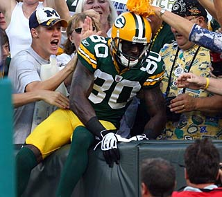 Donald Driver gets his first Lambeau Leap of the season after his 53-yard TD.  (Getty Images)