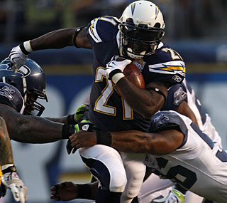 LaDainian Tomlinson finally sees some preseason action, playing in two series for the Chargers.  (AP)