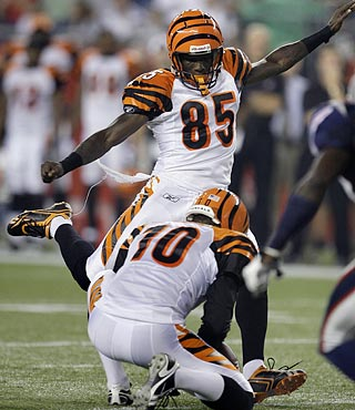 Chad Ochocinco kicks an extra point and later says, ' I think Ronaldinho would be proud of me right now.'  (AP)