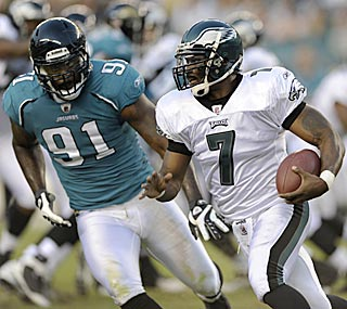 Michael Vick creates excitement but little offense, yet his return is mistake- and incident-free.  (AP)