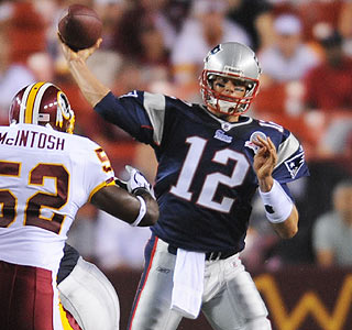 Tom Brady has a solid night (12 of 19, 150 yards, two TDs) before injuring his right shoulder.