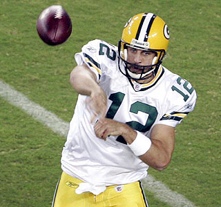 Aaron Rodgers throws for 258 yards and three touchdowns to open an early lead for Green Bay.