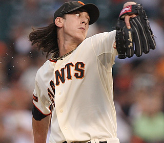 Tim Lincecum earns his first victory since Aug. 1, striking out eight over eight scoreless innings.  (Getty Images)