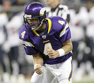 Brett Favre is pumped up while leading the Vikings, especially after his second-quarter TD pass.  (AP)