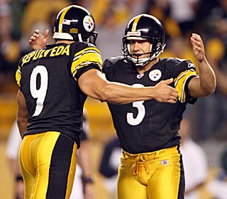 Steelers punter and holder Daniel Sepulveda hugs Jeff Reed after his game-winning 33-yard field goal.