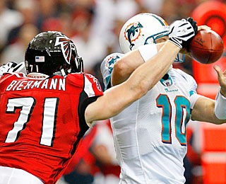 Kroy Biermann hits Dolphins quarterback Chad Pennington and knocks the ball loose for a fumble.