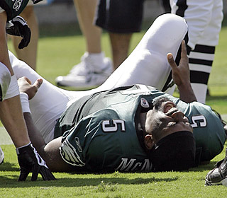 Donovan McNabb grimaces on the ground after injuring his rib on a 3-yard touchdown run in the third quarter.