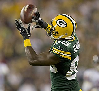 Aaron Rodgers' long pass comes down into Greg Jennings' hands for the game-winning touchdown.