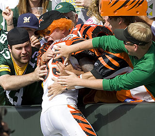 Chad Ochocinco executes his Lambeau leap after spotting some orange in a sea of green.