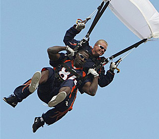 Shannon Sharpe starts the day off in style by skydiving into Invesco Field.