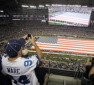 A crowd of 105,121 -- the largest ever to witness an NFL regular-season game -- fills new Cowboys Stadium.