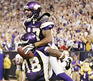 Greg Lewis catches the game-winning touchdown from Brett Favre with just two seconds left.