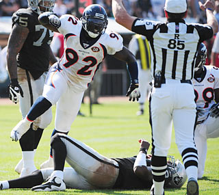 DE Elvis Dumervil and the Broncos defense rack up three sacks, two interceptions and a fumble recovery.