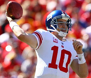 Eli Manning throws for three touchdowns before leaving the game with a bruised heel.
