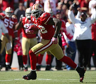 'Any day you look up and see a goose egg it's great,' says Patrick Willis, who runs back an INT.