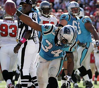 DeAngelo Williams finds the end zone twice -- including the game-winner -- and totals 152 yards.  (AP)