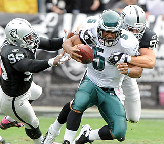 The Raiders make life unpleasant for Donovan McNabb, sacking him six times in the victory.  (US Presswire)