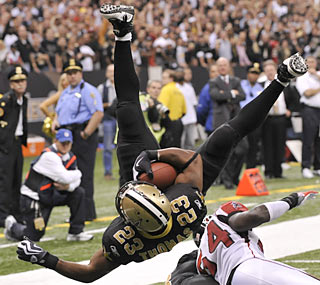 Pierre Thomas goes airborne late in the fourth quarter for his second touchdown of the game.