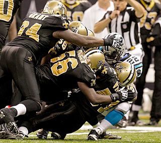 After trailing throughout the first half, the Saints clamp down against the feisty Panthers.  (US Presswire)