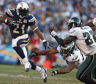 LaDainian Tomlinson runs for a season-high 96 yards and two touchdowns on 24 carries.  (Getty Images)