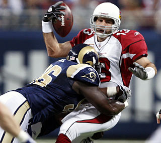 Kurt Warner doesn't leave St. Louis unscathed, but the NFC West-leading Cardinals pull out a victory.  (AP)