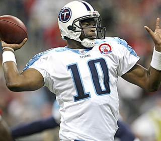 Vince Young throws for one TD and runs for 73 yards to improve to 2-0 as a starter in his hometown.