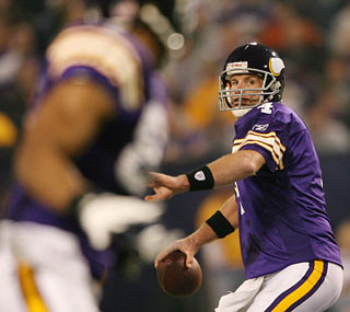 Brett Favre throws for three TDs against the Bears to increase his season total to 24.  (Getty Images)
