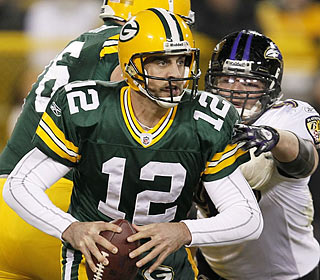 Aaron Rodgers completes 26 of 40 pass attempts for 263 yards and three touchdowns in the home victory.