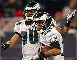 Quintin Demps (left) congratulates DeSean Jackson after scoring on a 72-yard punt return in the second quarter.
