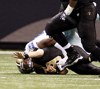 The Cowboys defense torments Drew Brees, who turns the ball over three times including a back-breaking fumble.