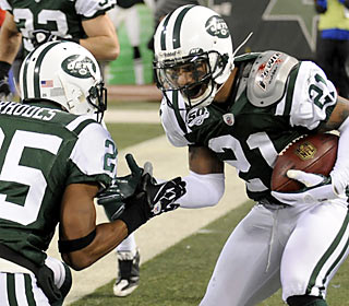 Kerry Rhodes and Dwight Lowery celebrate as their defensive unit earns its first home shutout since Dec. 14, 2003.