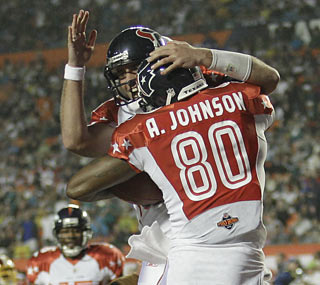 Matt Schaub gets help from Texans teammate Andre Johnson, who catches a 33-yard TD for the game's first score.