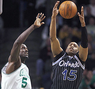 Kevin Garnett and the slumping Celtics come up short vs. Vince Carter's Magic.  (AP)
