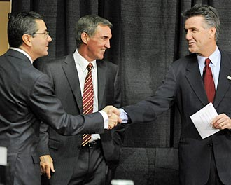 Dan Snyder (left) now tries to get it right with Mike Shanahan and Bruce Allen. (Getty Images)