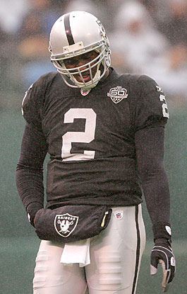 JaMarcus Russell's expanding girth exceeds his worth to the Raiders. (Getty Images)