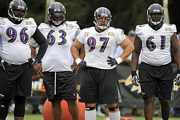 Terrence Cody (63) fits right in on a bulky Ravens D-line. (US Presswire)
