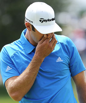 A triple-bogey 7 on the second hole was only the beginning of Dustin Johnson's problems, and he never recovered. (Getty Images)
