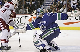 A rusty Roberto Luongo gives up a goal on the first shot he faces from Joakim Lindstrom. (AP)