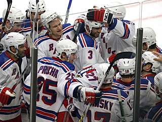 New York players clear the bench to celebrate Chris Drury's tally in the extra session. (Getty Images)