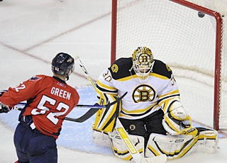 Left alone in front, Mike Green beats Tim Thomas with a slapper for his 12th goal. (AP)