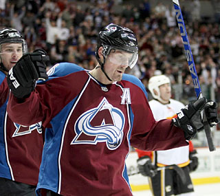 Milan Hejduk celebrates after becoming just the fourth player in Avs history to tab 300 goals.  (US Presswire)