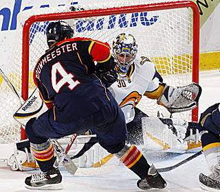 Ryan Miller stops Jay Bouwmeester for one of the goalie's 27 saves in the shootout win.  (US Presswire)