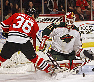 Niklas Backstrom saves 40 of 41 shots as the Wild drop the 'Hawks to 14-2-5 at the UC.  (US Presswire)