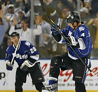 Vincent Lecavalier (4) helps the Lightning beat the Stars in Tampa for the first time since Feb. 1996.  (AP)