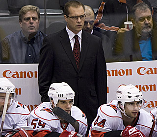 He might not show it here, but Paul Maurice likely enjoys the 'Canes beating his former team.  (AP)