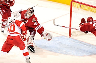 Keith Yandle dives to help, but Ilya Bryzgalov makes the save on Henrik Zetterberg. (Getty Images)